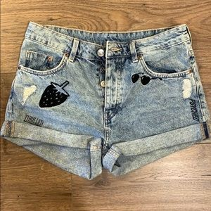 Denim shorts with graphic prints